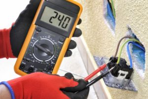 Electrician testing electrical equipment